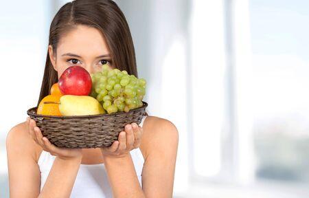 body conscious: Healthy Lifestyle, Fruit, Woman. Stock Photo