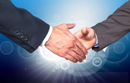 bridging the gap: Handshake, Business, Partnership. Stock Photo