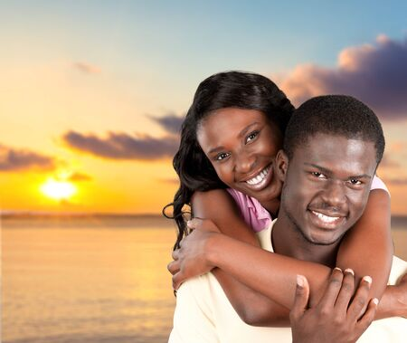 affectionate actions: Beach, Couple, Cheerful.