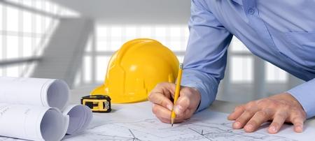 construction plans: Architect, engineer, designer. Stock Photo