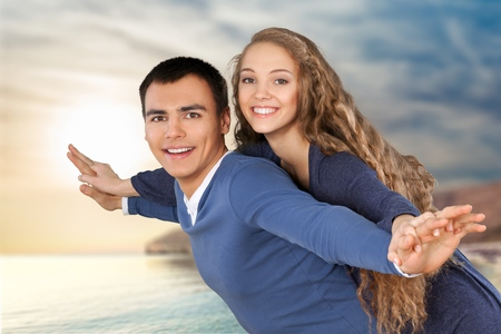 affectionate action: Beach, Heterosexual Couple, Cheerful.