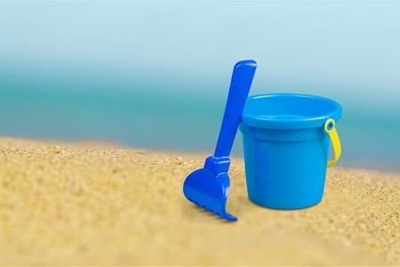 bucket and spade: Bucket, spade, sand.