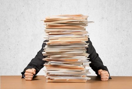 overburdened: Emotional Stress, Paperwork, Frustration. Stock Photo