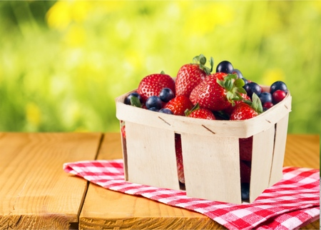 small group of objects: Strawberry, Basket, Berry.