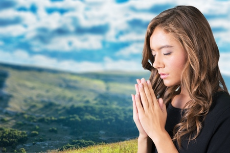 worshipper: Praying, Women, People. Stock Photo