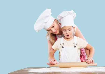 Mom, kid, cooking. Stock Photo