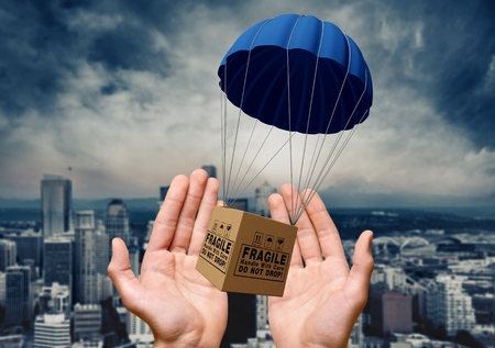 Parachute, Package, Box. Stock Photo