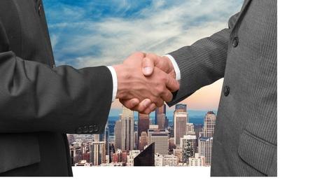 merging together: Handshake, Business, Finance.