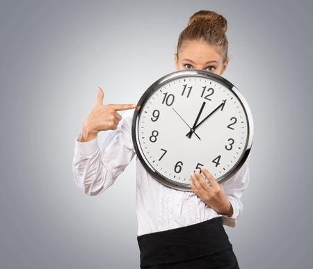 curfew: Waiting, Clock, Women. Stock Photo