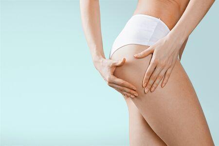 woman panties: Buttocks, pinching, panties. Stock Photo