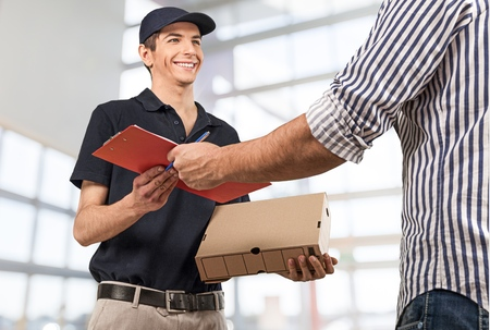 door man: Delivering, Messenger, Delivery Person. Stock Photo