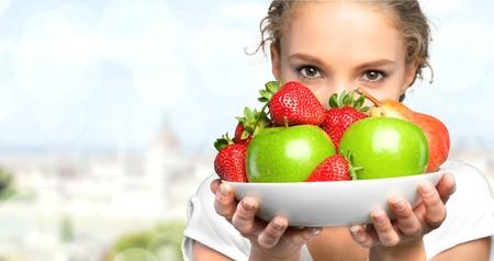 body conscious: Healthy Lifestyle, Fruit, Women. Stock Photo