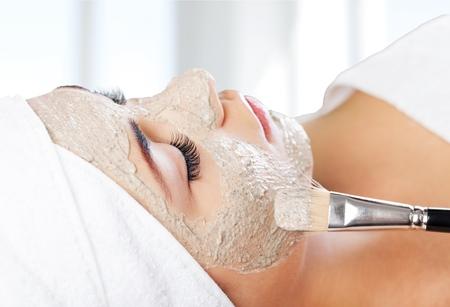 facial: Facial Mask, Spa Treatment, Mud. Stock Photo