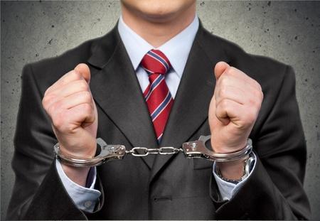 手錠、ホワイト カラー犯罪、犯罪者。 写真素材