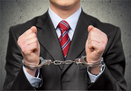 Handboeien, White Collar Crime, Criminal. Stockfoto