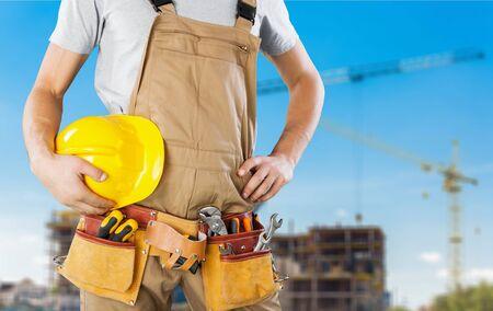 rolledup sleeves: Repairman, closeup, clothing.