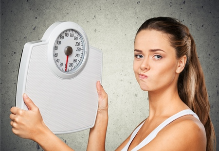 failure: Dieting, Weight Scale, Women. Stock Photo