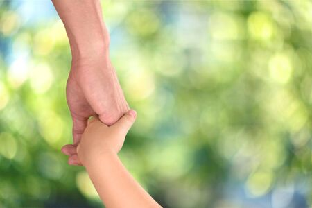 Holding Hands, Father, Parent. Stock Photo