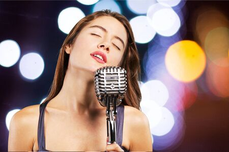singer with microphone: Singer, sing, woman.