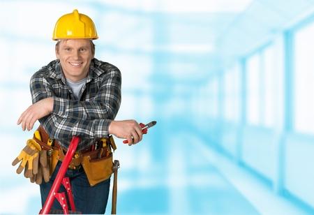 class maintenance: Electrician, Manual Worker, Construction Worker. Stock Photo