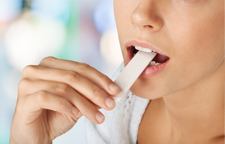 Chewing Gum, Eating, Women. Stock Photo