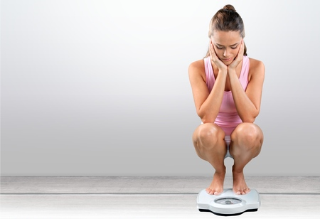 woman diet: Dieting, Women, Weight Scale. Stock Photo