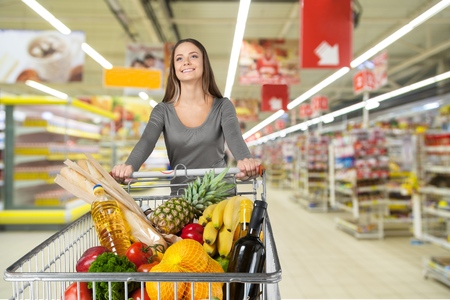 woman shopping cart: Supermarket, Shopping, Groceries. Stock Photo