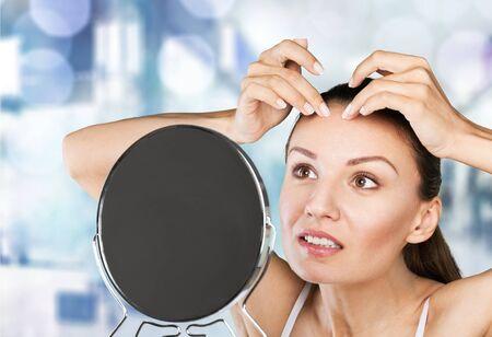 pimple: Girl, mirror, spot. Stock Photo