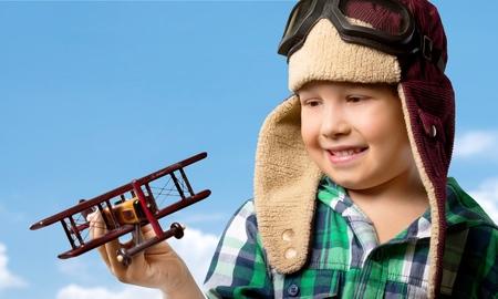 looking around: Boy, toy, flight.