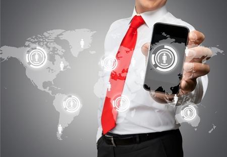 telephone: Mobile Phone, Telephone, Holding. Stock Photo