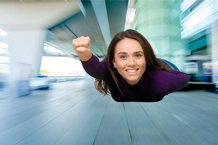 business in hand: Superhero, Women, Flying.