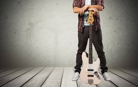 young musician: Guitar, guitarist, guy. Stock Photo