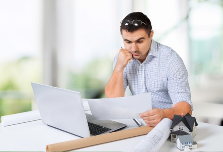 work from home: Work, home, investment. Stock Photo