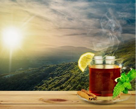 morning tea: Mountain, cup, sun.