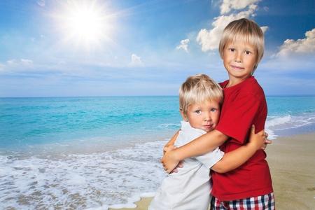 tickling: Hugging, son, tickling. Stock Photo