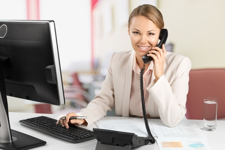 sales executive: Telephone, Women, Office. Stock Photo