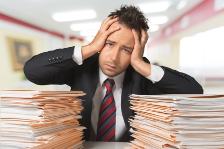 tearing: Paperwork, Busy, Businessman. Stock Photo
