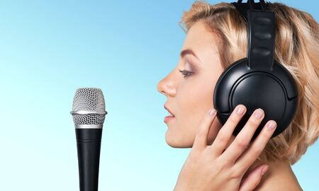 singer with microphone: Singer, Microphone, Singing.