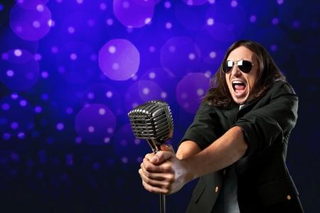 Singing, singer, male. Stock Photo