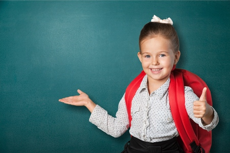 little girl child: School kid, first, uniform. Stock Photo