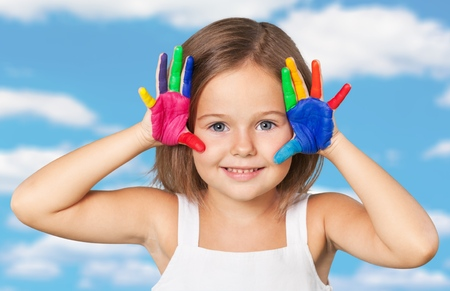 painted hands: Kid with painted hands, indian, paintings. Stock Photo