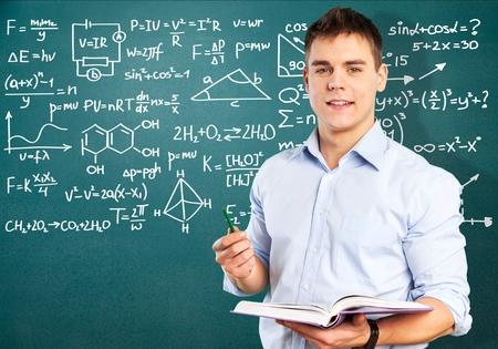 Teacher, blackboard, board. Foto de archivo