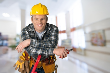 working people: Electrician, Manual Worker, Construction Worker. Stock Photo