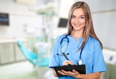 portapapeles: Enfermera, Scrubs, Asistencia sanitaria y medicina. Foto de archivo