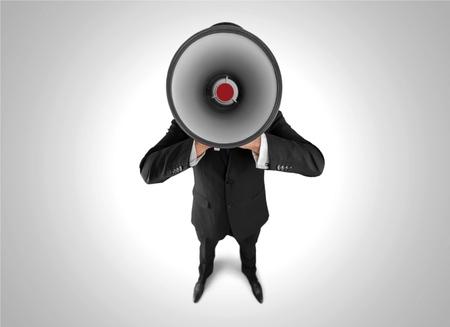 businessman using a megaphone: Megaphone, Using Voice, Advertisement.
