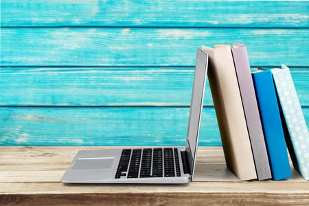 bookshelf digital: Studying, literature, laptop.