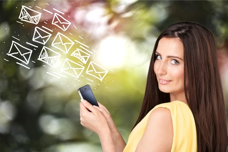 text messaging: Mobile Phone, Text Messaging, Women. Stock Photo
