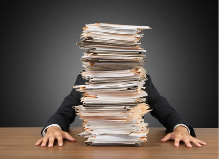 busy person: Emotional Stress, Paperwork, Frustration. Stock Photo