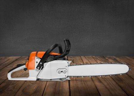 gardening equipment: Chainsaw, Isolated, Gardening Equipment. Stock Photo