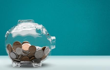 Ahorros, moneda, transparente. Foto de archivo